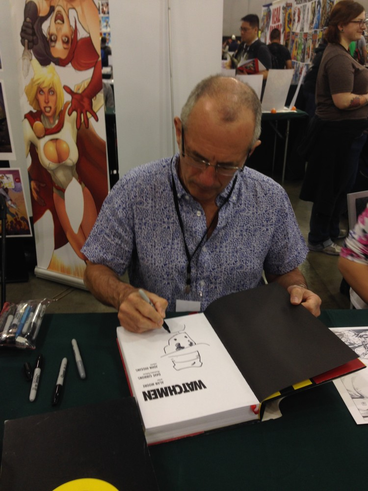 Dave Gibbons signing my copy of Absolute Watchmen