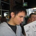 Alex Siquig reading Black Snow issue 1