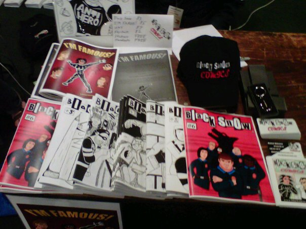 Black Snow Comics table merch